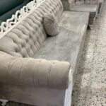 velvet and white grey 6 seater sofa with round cushion
