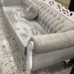 velvet and white grey 6 seater sofa with round cushion next side